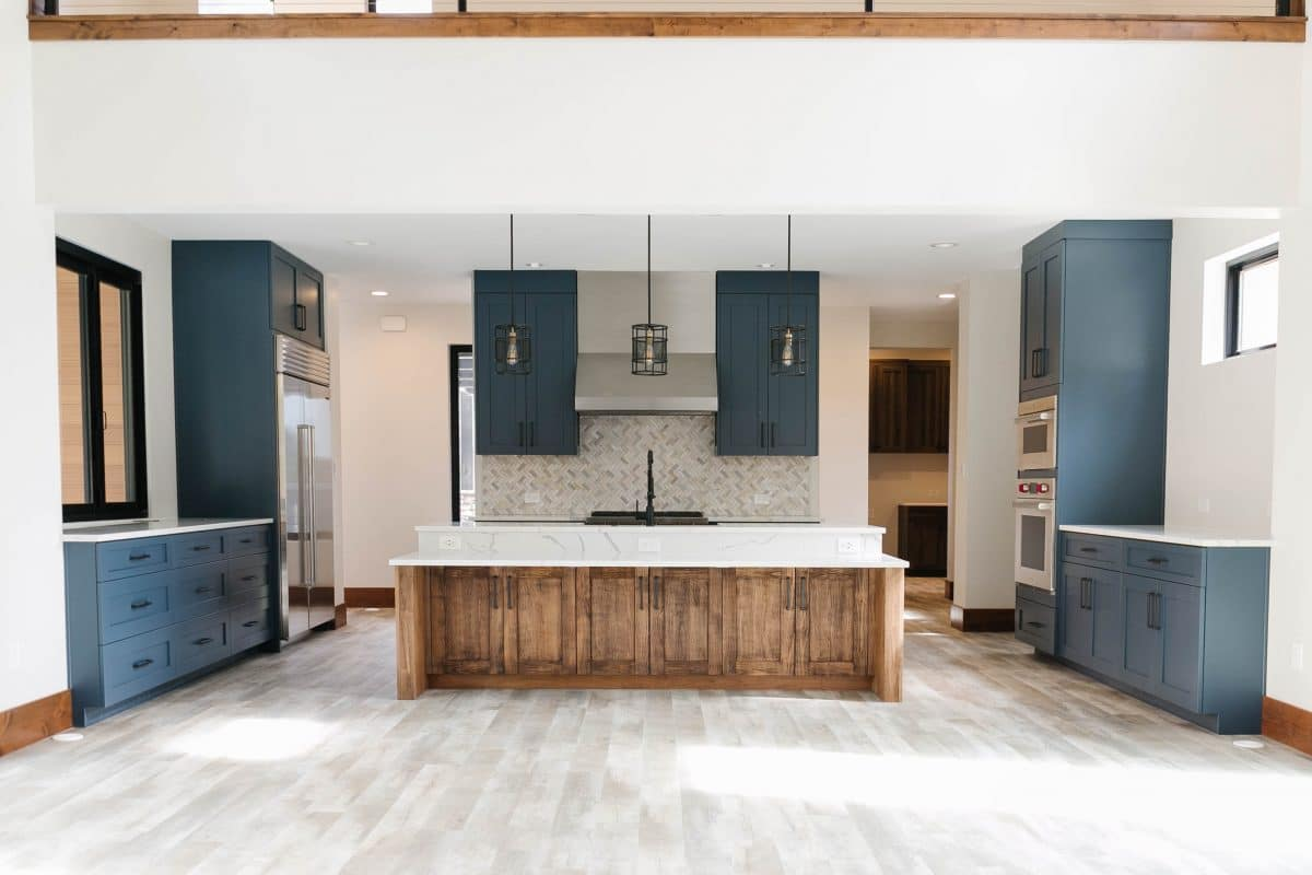 Mountain Modern Custom Colorado Home with Blue and Wood Cabinetry | Gowler Homes